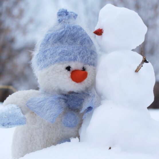 Snowman next to felted snowman