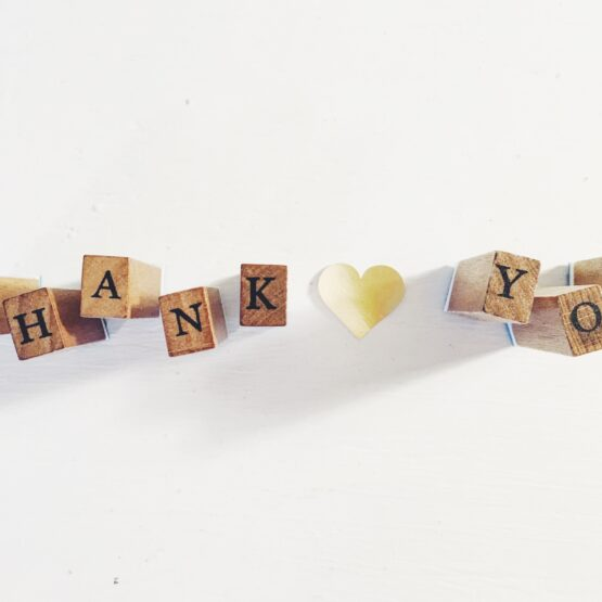 Thank you spelled out in wooden blocks